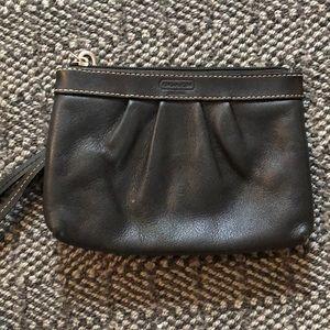 Coach black leather wristlet.